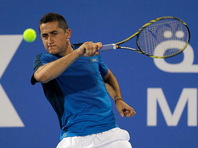 Nicolas Almagro returns the ball during the World Tennis Championship final against Novak Djokovic on December 29, 2012
