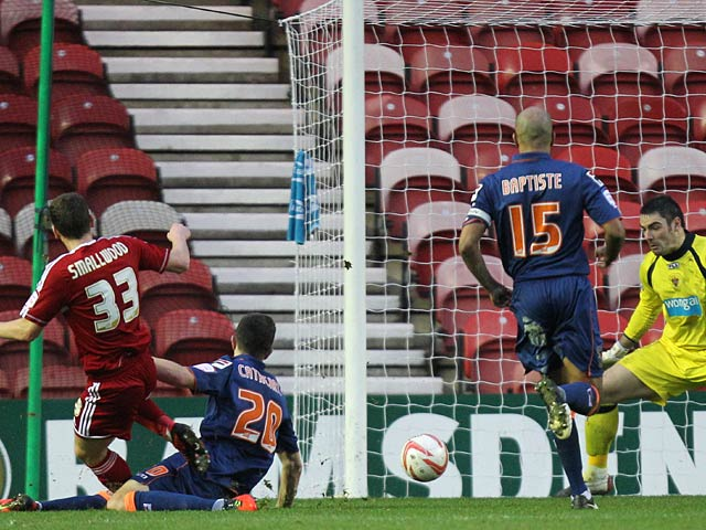Middlebrough's Richard Smallwood scores his team's second goal on December 29, 2012