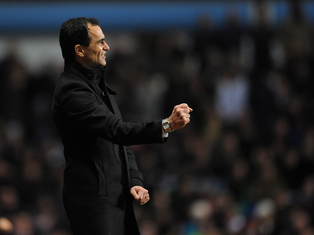 Wigan manager Roberto Martinez celebrates his team's goal on December 29, 2012