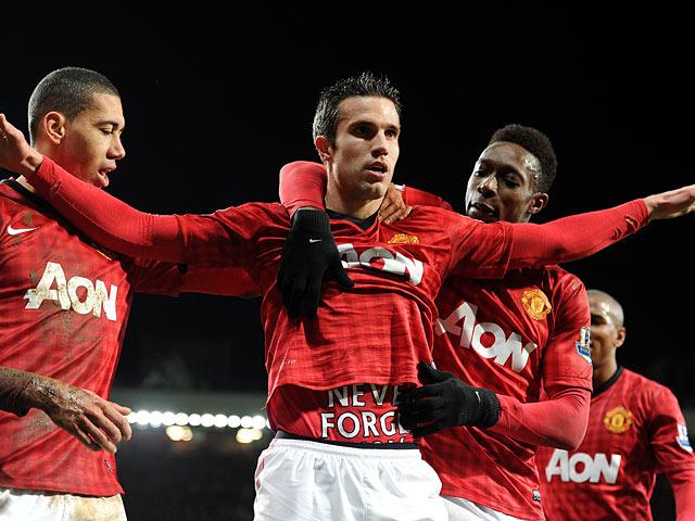 Robin Van Persie celebrates after scoring his team's second goal on December 29, 2012