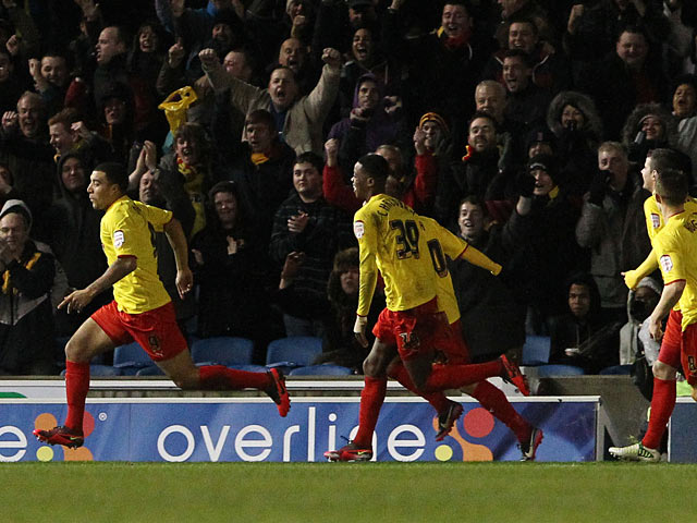 Watford's Troy Deeney is chased down by team mates after scoring the opener against Brighton on December 29, 2012