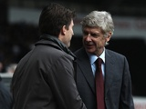Arsenal manager Arsene Wenger is greeted by Swans boss Michael Laudrup before the FA Cup tie on January 6, 2013
