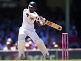 Sri Lanka's Dimuth Karunaratne cuts the ball against Australia on January 5, 2013