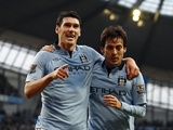 City's Gareth Barry is congratulated by David Silva after scoring the second against Watford on January 5, 2013