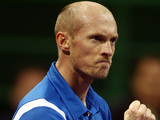 Nikolay Davydenko celebrates his win over David Ferrer in the Qatar Open on January 4, 2013