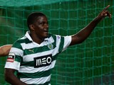 Sporting's midfielder William Carvalho celebrates after scoring a goal during the Portuguese football match Sporting CP vs FC Pacos de Ferreira on December 1, 2013