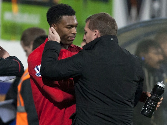 Liverpool boss Brendan Rodgers congratulates Daniel Sturridge following a goalscoring debut at Mansfield on January 6, 2013