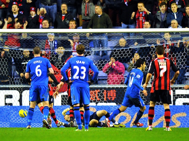 Wigan's Jordi Gomez misses a penalty but slots home the rebound against Bournemouth on January 5, 2013