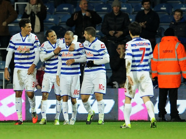 QPR players congratulate Kieron Dyer on his late goal against West Brom on January 5, 2013