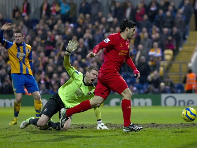 Mansfield players protest Luis Suarez's controversial goal for Liverpool on January 6, 2013