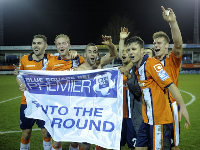 Players of non-league Luton Town celebrate knocking Championship side Wolves out of the FA Cup on January 5, 2013