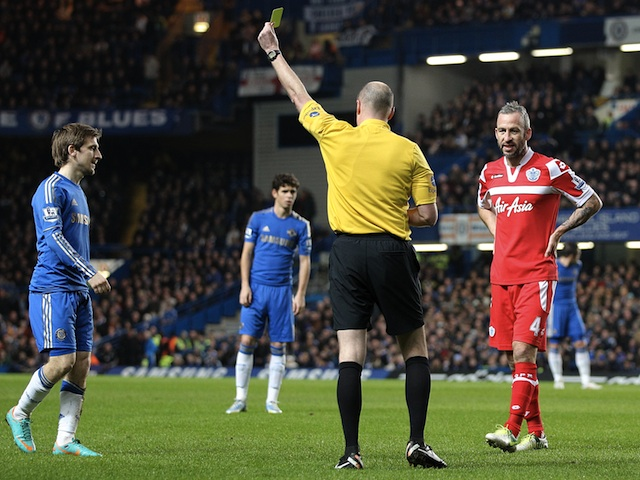 Chelsea's Marko Marin is booked for a reckless tackle against QPR on January 2, 2013
