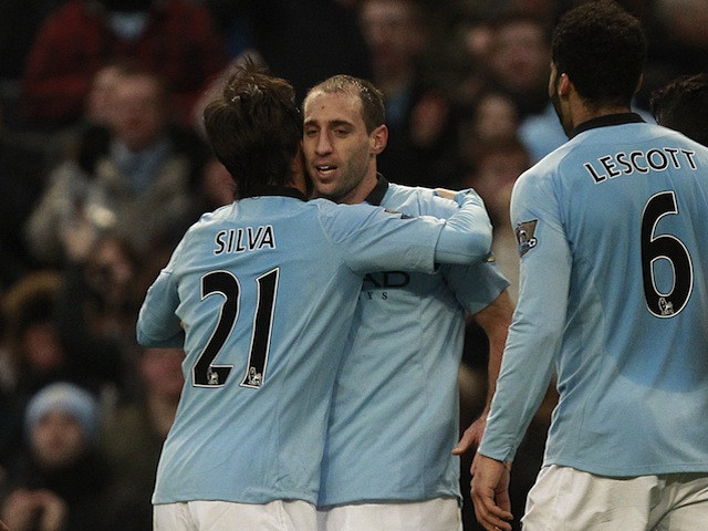 City defender Pablo Zabaleta is congratulated on his goal against Stoke on January 1, 2013