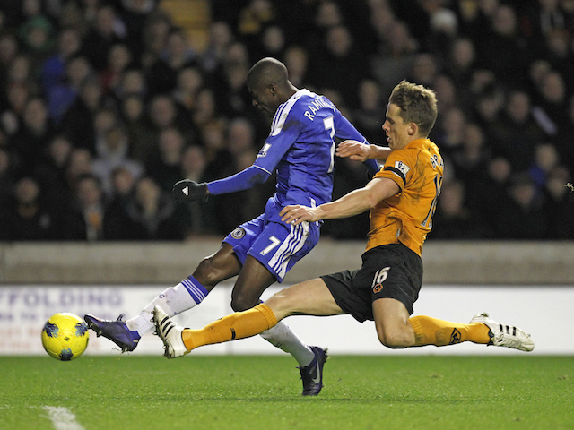 Chelsea's Brazilian midfielder Ramires shoots under pressure from Wolverhampton Wanderers' Scottish defender Christophe Berra (R) during the English Premier League football match on January 2, 2012