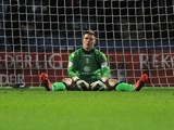 Birmingham goalie Jack Butland sits dejected after a late Huddersfield equaliser on January 12, 2013
