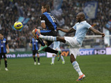 Michael Ciani of Lazio and Atalanta's German Denis battle for the ball in their Serie A clash on January 13, 2013