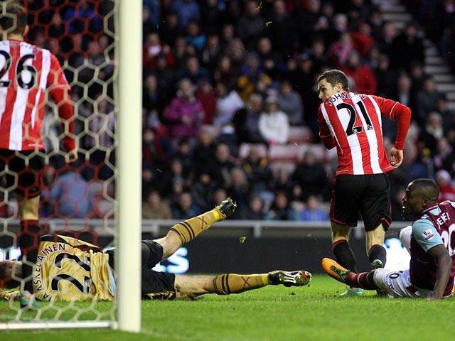 Adam Johnson scores his team's second goal against West Ham on January 12, 2013