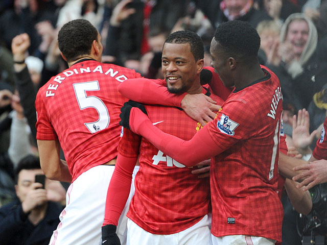 Manchester United defender Patrice Evra celebrates scoring his teams second goal against Liverpool on 13 January, 2013