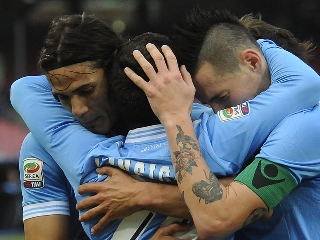 Napoli players Marek Hamsik and Edinson Cavani congratulate teammate Lorenzo Insigne for scoring his sides third goal in their Serie A match against Palermo on January 13, 2013