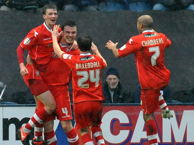 Walsall players congratulate goalscorer Paul Downing after a goal against Preston on January 13, 2013