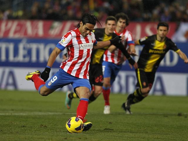 Atletico striker Radamel Falcao scores a goal against Zaragoza on January 13, 2013