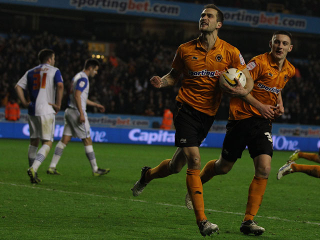 Wolverhampton Wanderers player Roger Johnson celebrates scoring the equaliser against Blackburn Rovers on 11 January, 2013