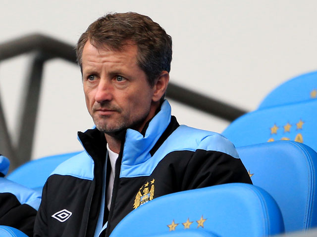 Manchester City academy coach Scott Sellars watches on as City play Norwich City at the Etihad Stadium on 3 December, 2011