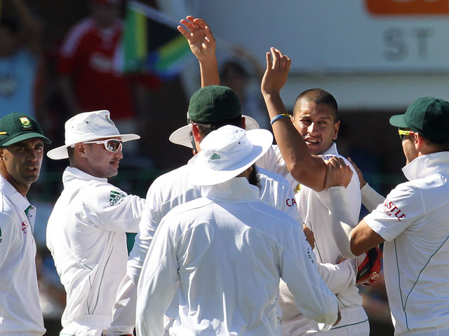 South Africa players celebrate with bowler Rory Kleinveldt during their match with New Zealand on 13 January, 2013