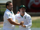 South Africa's Dean Elgar congratulates his team mates Jacques Kallis after dismissing New Zealand's Dean Brownlie on January 14, 2013