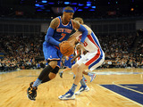 Carmelo Anthony of the New York Knicks gets away from Detroit Pistons player Kyle Singler on January 17, 2013