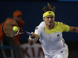 Spain's David Ferrer makes a forehand return in his third round match at the Australian Open tennis championship on January 18, 2013
