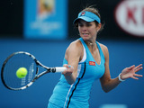 Germany's Julia Goerges plays a shot during her third round match against Zheng Jie at the Australian Open tennis championship on January 18, 2013