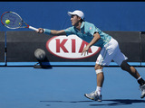Kei Nishikori of Japan stretches for a shot during his second round match at the Australian Open tennis championship on January 16, 2013