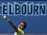 Spain's Nicolas Almagro serves to Steve Johnson in their first round match at the Australian Open tennis championship on January 14, 2013