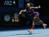 Serena Williams stretches for the ball in her first round match with Edina Gallovits-Hall at the Australian Open tennis championship on January 15, 2013