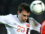 Norway's Vegard Forren heads the ball during an international match on November 14, 2012