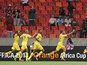Mali skipper Seydou Keita celebrates his goal as teammates follow, after a strike against Niger on January 20, 2013