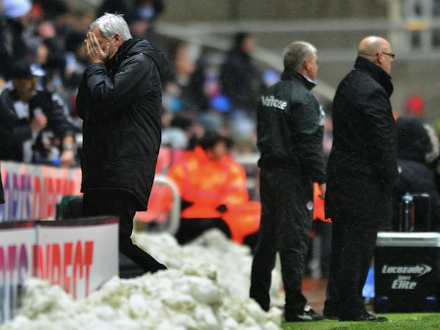 Newcastle boss Alan Pardew looks away after his side concede a second goal to Reading on January 19, 2013