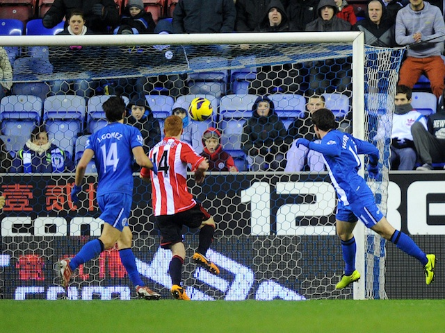 Wigan's on-loan forward Angelo Henriquez heads in his first goal for the club against Sunderland on January 19, 2013
