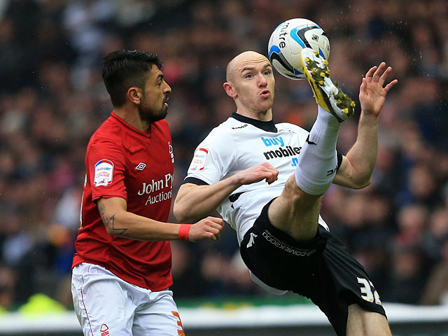 Derby's Conor Sammon and Forest's Gonzalo Jara battle for the ball on January 19, 2013