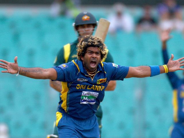 Sri Lanka's Lasith Malinga celebrates taking the wicket of Australia's Mitchell Johnson on January 20, 2013