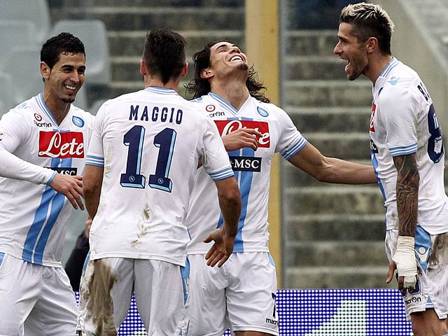 Napoli's Edinson Cavani is congratulated by team mates after heading in the equaliser against Fiorentina on January 20, 2013