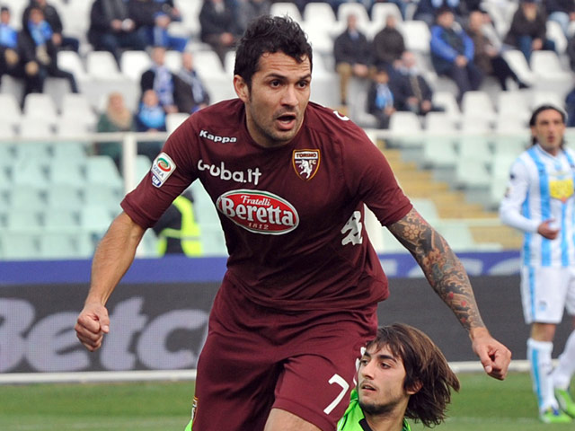 Torino's Mario Alberto Santana celebrates after scoring the opening goal against Pescara on January 20, 2013