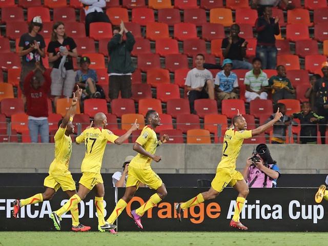 Mali skipper Seydou Keita celebrates his goal as teammates follow, after a strike against Niger on January 20, 2013