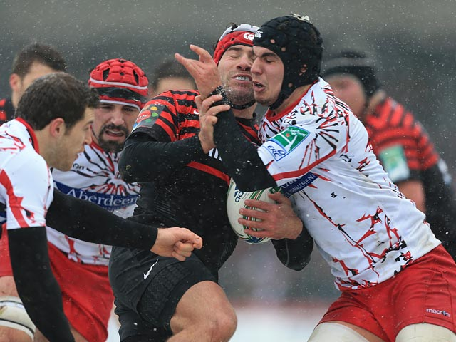 Saracens' Schalk Brits is stopped by Edinburgh's Stuart McInally during their Heineken Cup match on January 20, 2013