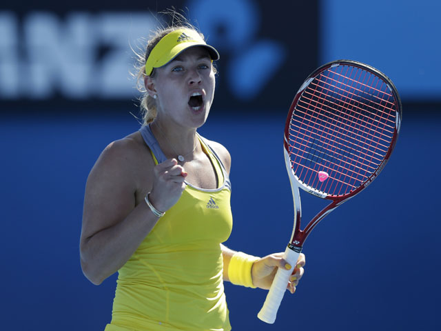 German Angelique Kerber celebrates after winning her first round match against Elina Svitolina at the Australian Open tennis championship on January 14, 2013