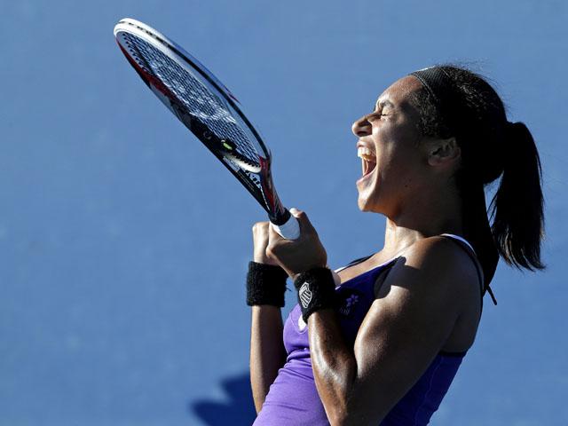 Britain's Heather Watson celebrates winning her second round match at the Australian Open tennis championship on January 16, 2013