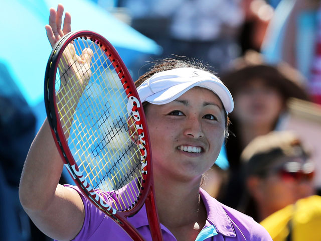 Misaki Doi of Japan thanks the crowd after her first round win over Petra Martic at the Australian Open tennis championship on January 14, 2013