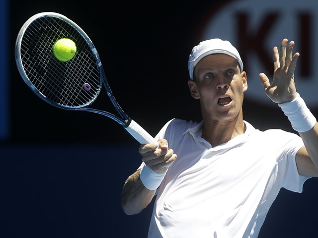 Tomas Berdych celebrates hits a return at the Australian Open tennis championship on January 16, 2013