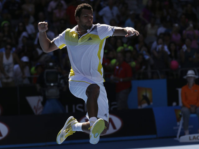 Jo-Wilfried Tsonga of France leaps in the air to celebrate his first round win over Michael Llodra  at the Australian Open tennis championship on January 15, 2013